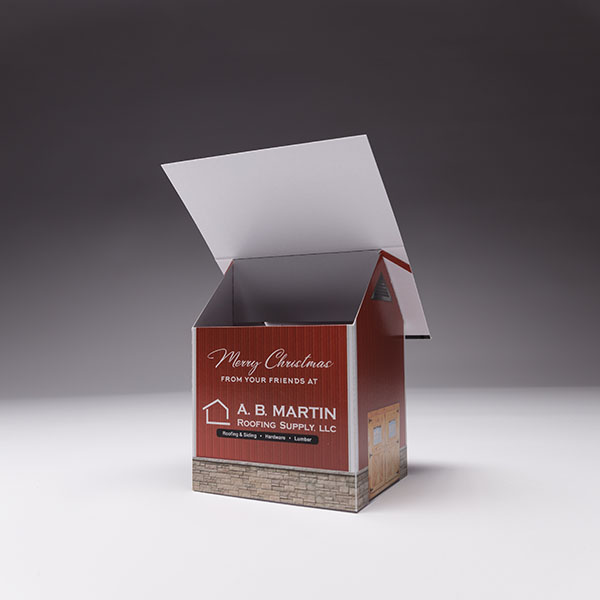 Our holiday cards have staying power, Use the Pop Up House to leave a lasting impression on your clients desk